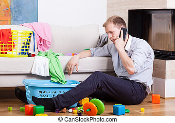Man being alone at home with child - Image of man being...