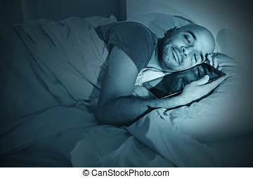 young man in bed at night sleeping happy together with...