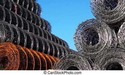 Stacked Wire Rolls Panning - Outdoor panning shot against a...