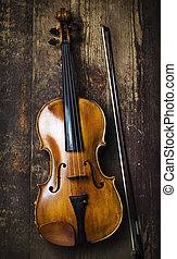 Viola on rustic wooden background