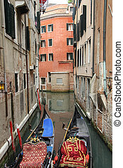 Venetian landscape with gondolas. Canal in Venice with gaily...