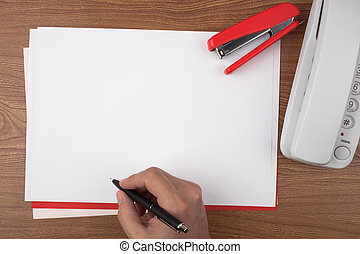 Hand writing on sheets of paper - A hand writing on sheets...