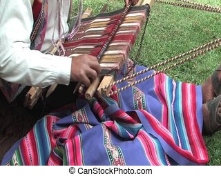 weaving a rug - Man weaving a rug in Peru