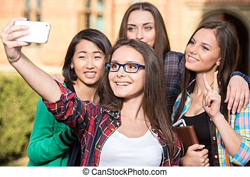 Students - Portrait of female students that are making...