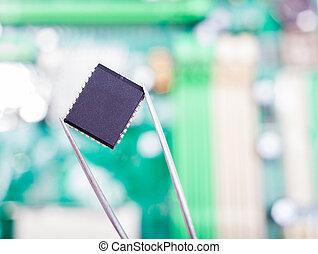 microchip in the tweezers