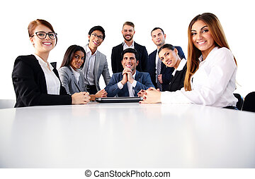 Group of a happy businesspeople on the meeting