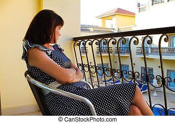 Woman - Stock photos - Woman sitting on the balcony at the...