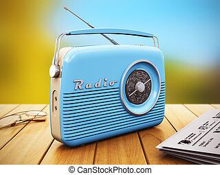 Old radio on wooden table outdoors - Old blue vintage retro...