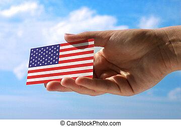 small flag of USA - hand holding small flag of  USA