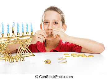 Jewish Child on Hanukkah - Little boy playing driedel and...