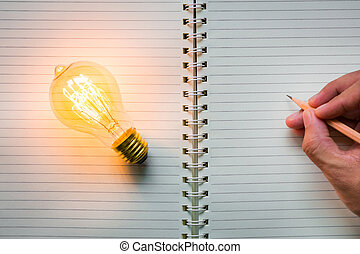 Hand write over Note book and light bulb - Hand write over...