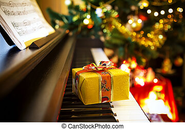 Christmas gift on piano Christmas decoration with gift on...
