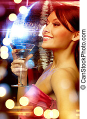woman with cocktail and disco ball