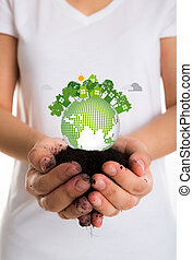 Eco friendly earth in female hands