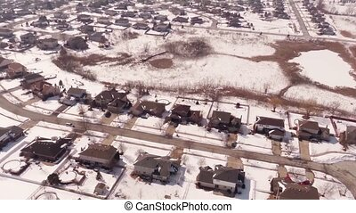 Aerial of homes in a snow - Overhead aerial view of...