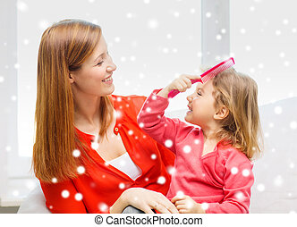mother and daughter with comb - family, childhood, holidays...