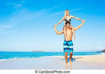 Attractive Couple Playing on the Beach - Attractive Couple...