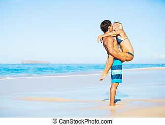 Couple Kissing on Tropical Beach - Attractive Couple Kissing...