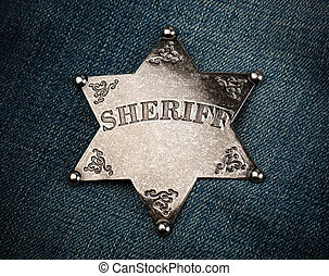 Sheriff star badge on blue denim background - Vintage...
