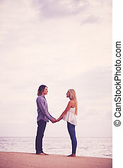 Young Couple Kissing on the Sea Shore - Young Romantic...