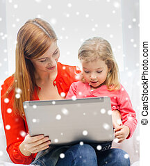 happy mother and daughter with laptop computer - family,...