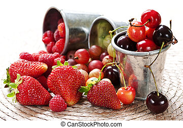 Fruits and berries - Assorted summer fruits and berries in...