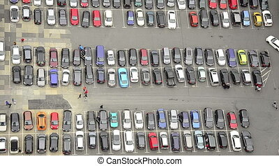 a lot of cars parking in a city