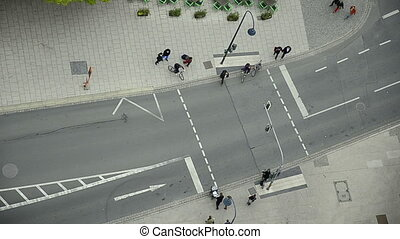 people crossing the street at a traffic light