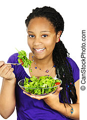 Girl having salad - Isolated portrait of black teenage girl...