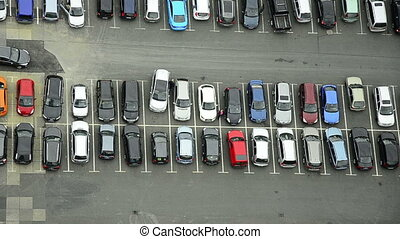 a lot of cars parking in a city - many cars parking and...