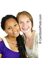 Two girlfriends - Isolated portrait of two diverse teenage...