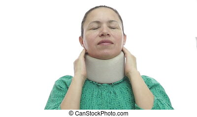 Woman With Neck Brace In Pain - A woman in a green blouse...