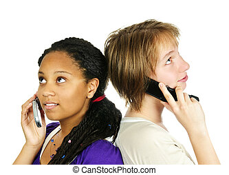 Teen girls with mobile phones - Isolated portrait of two...