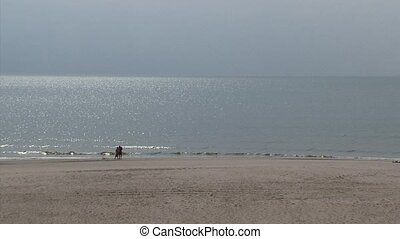 North Sea beach with couple at beach ridge + zoom out empty...