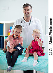 Pediatrician with his patients