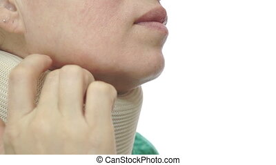 Woman With Neck Brace Scratching - A woman in a green blouse...