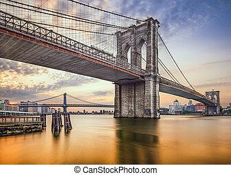 Brooklyn Bridge in New York City, USA at dawn.