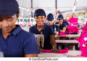 african textile workers on the production line - happy...