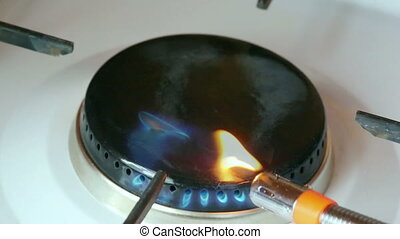 gas ignited by lighter in the burner gas stove