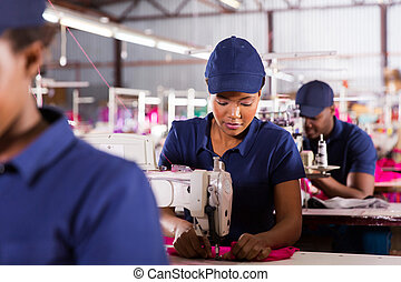 textile factory machinist working in production line -...