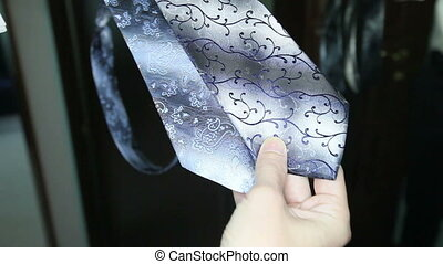 groom considers tie - groom choose the best tie for his...