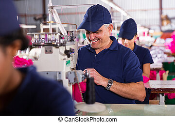 senior machinist sewing - happy senior machinist sewing in...