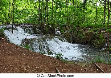 Plitvice Lakes , Croatia - small tropical waterfall in rain...