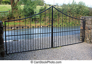 Security gates - Black security gates protecting a...