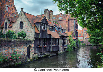 Bruges - Beautiful view of Bruges canals and architecture of...