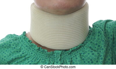 Woman In Neck Brace Tilt Up Close - A tilt up shot of a...