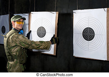 Man with target in shooting range
