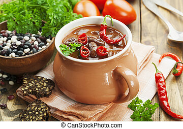 Chili soup with red beans and greens Mexican cuisine