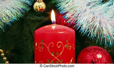 Christmas decorations and candle - pan view