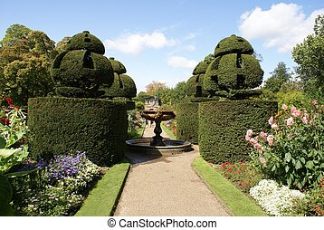 garden with fountain & yew topiary - garden path with...
